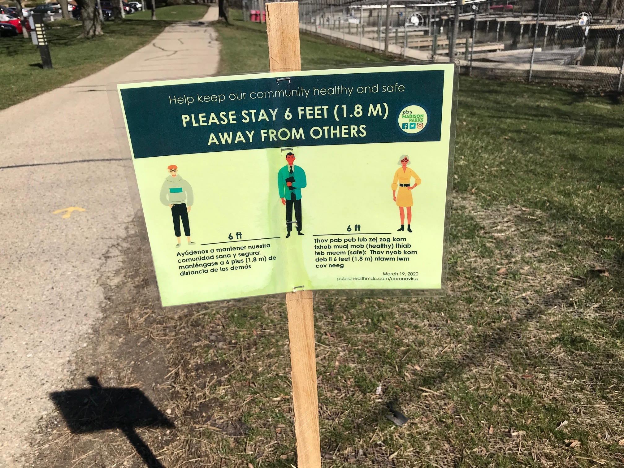Social distancing sign on Madison bike path