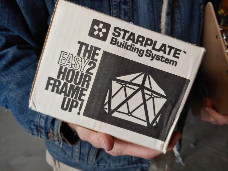Person holding Starplate™ box