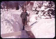Kent Liska with snow shovel, 1950s