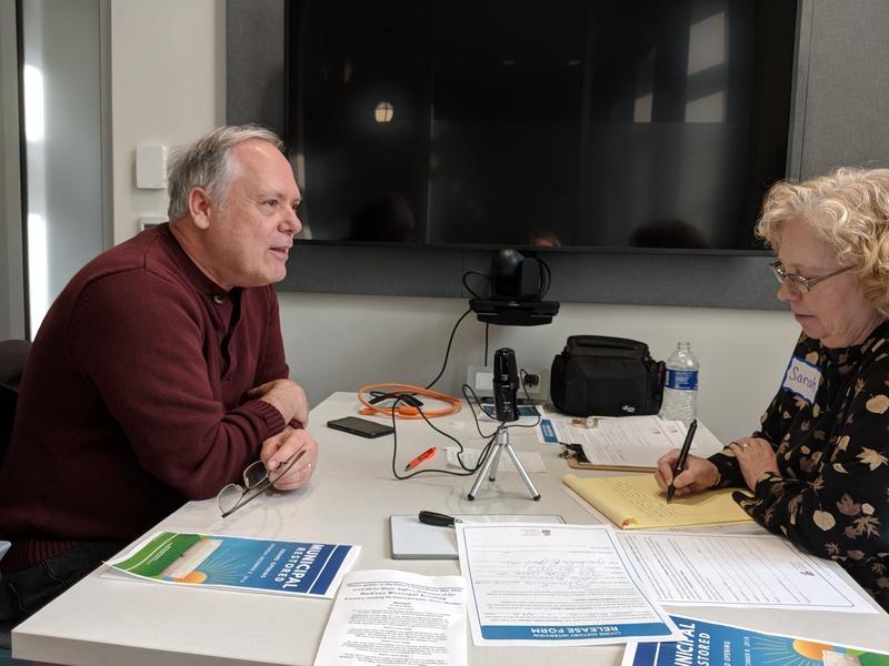 Photograph of Greg Mickells with interviewer, Municipal Restored, 2018