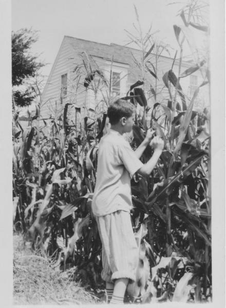Jim Crawmer in back yard at 3917 Paunack Avenue, ca. 1942
